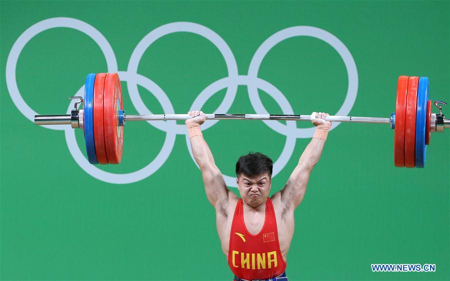 Long Qingquan of China competes during the men