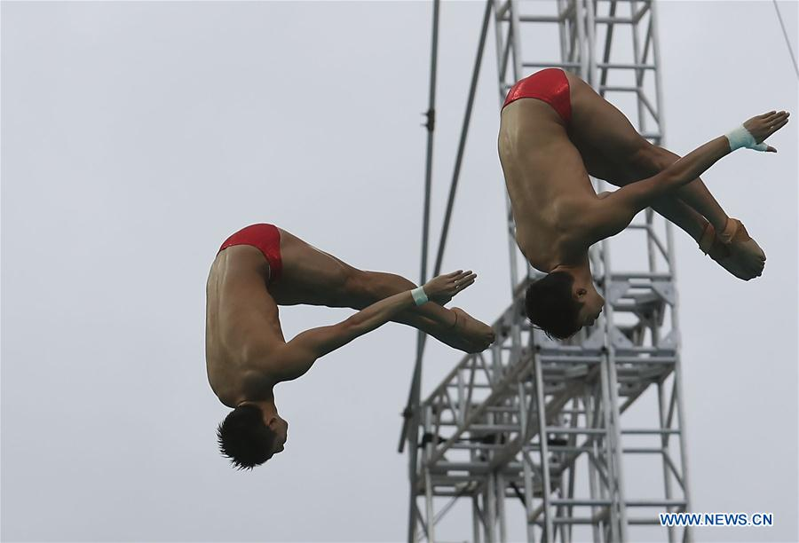 Lin Yue (L) and Chen Aisen of China compete during the men