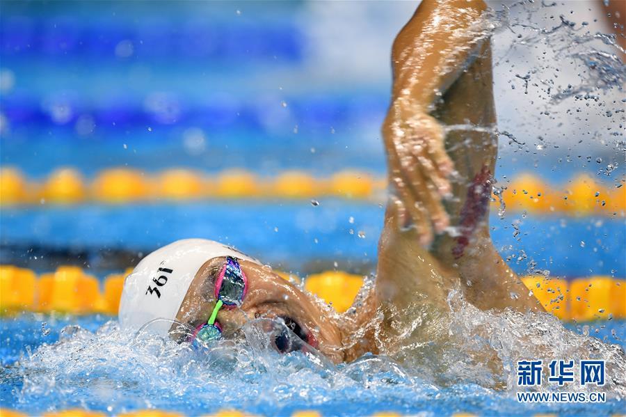 الصيني سون يانغ يفوز بذهبية 200 م سباحة حرة