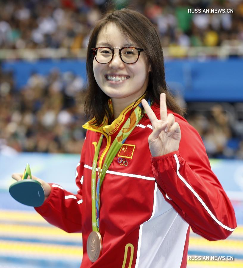 Китаянка Фу Юаньхуэй завоевала бронзовую медаль Олимпийских игр в заплыве на дистанции 100 метров на спине