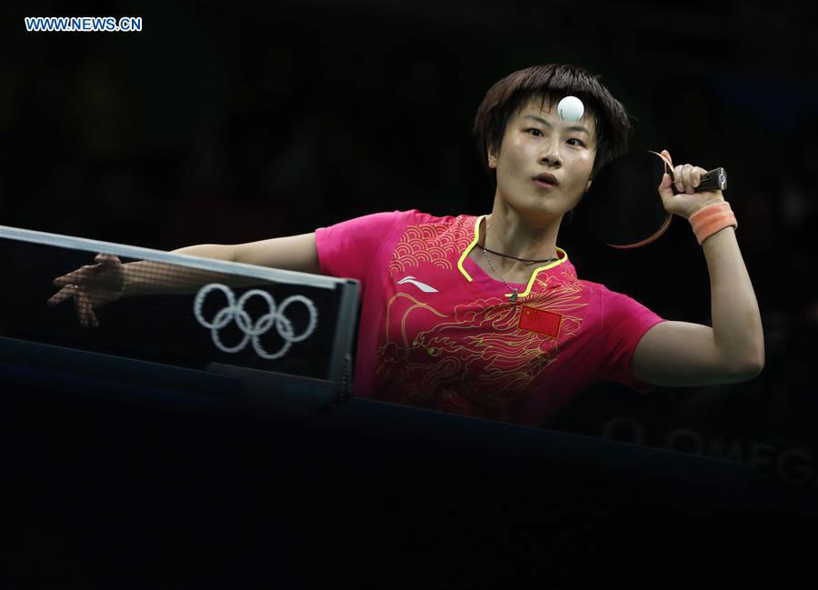China's Ding Ning returns the ball against her compatriot Li Xiaoxia during the women's singles gold medal match of table tennis at the 2016 Rio Olympic ...
