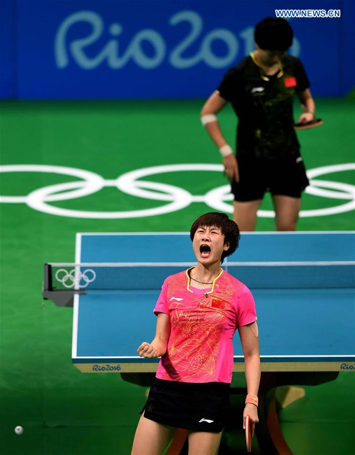 China's Ding Ning reacts during the women's singles gold medal match of table tennis against her compatriot Li Xiaoxia at the 2016 Rio Olympic Games in Rio ...