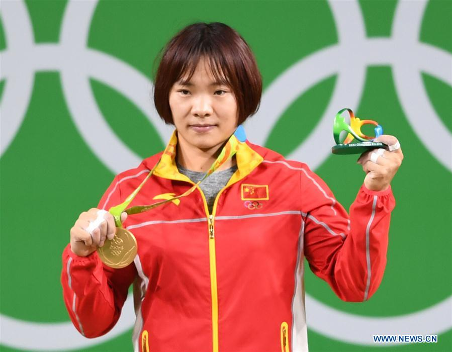 Xiang Yanmei of China celebrates during the awarding ceremony for the women
