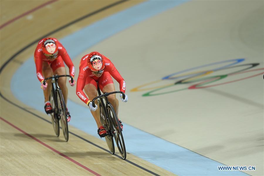 Zhong Tianshi (L) of China competes during the final of women