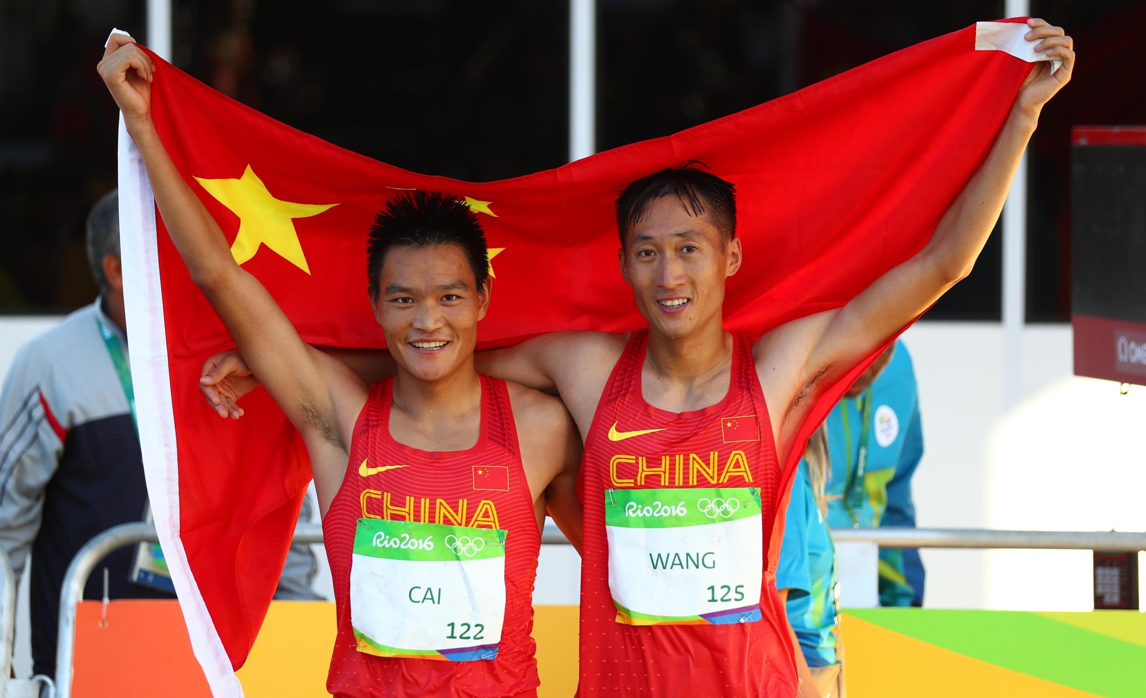 [高清优游品牌国际图]男人20千米赛跑 王镇夺金蔡泽林摘银
