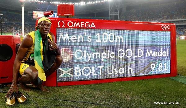 الجامايكي بولت يفوز بثالث لقب أولمبي في سباق 100م رجال