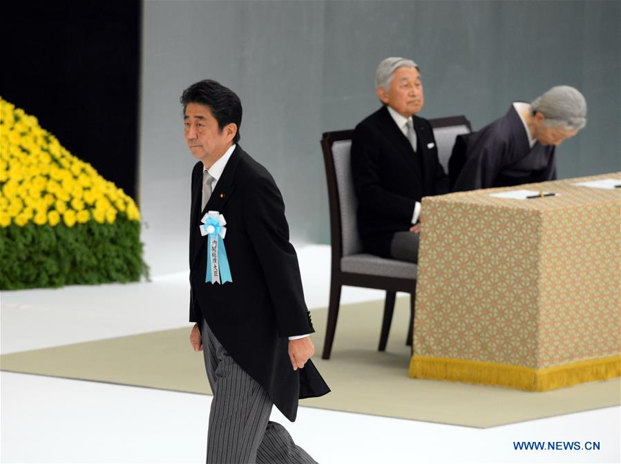 Japanese Prime Minister Shinzo Abe (front) attends the ceremony marking the 71st anniversary of Japan