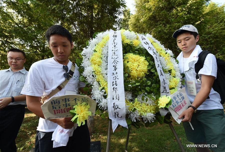 Delegates from Japan present a wreath to victims of the Nanjing Massacre during an assembly at the Memorial Hall of the Victims in Nanjing Massacre by Japanese Invaders in Nanjing, capital of east China