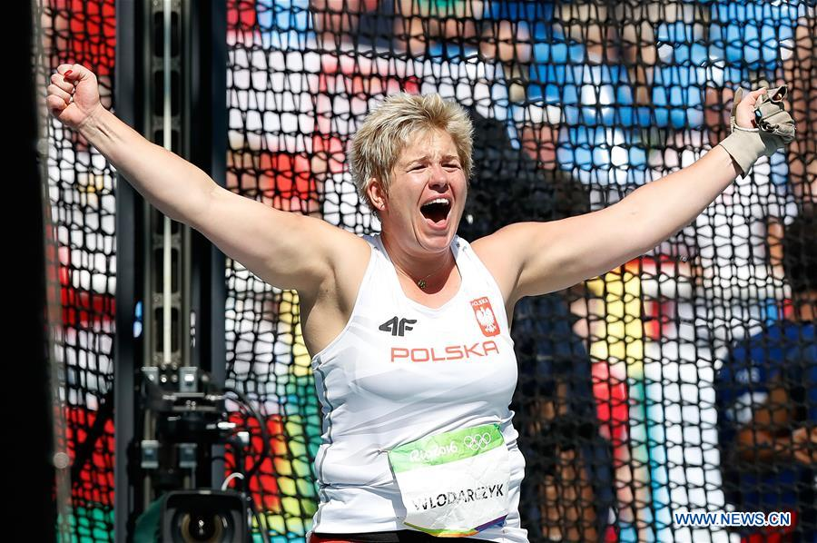 Poland's Anita Wlodarczyk celebrates during the women