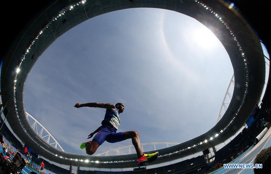 Christian Taylor of the United States competes during the final of men