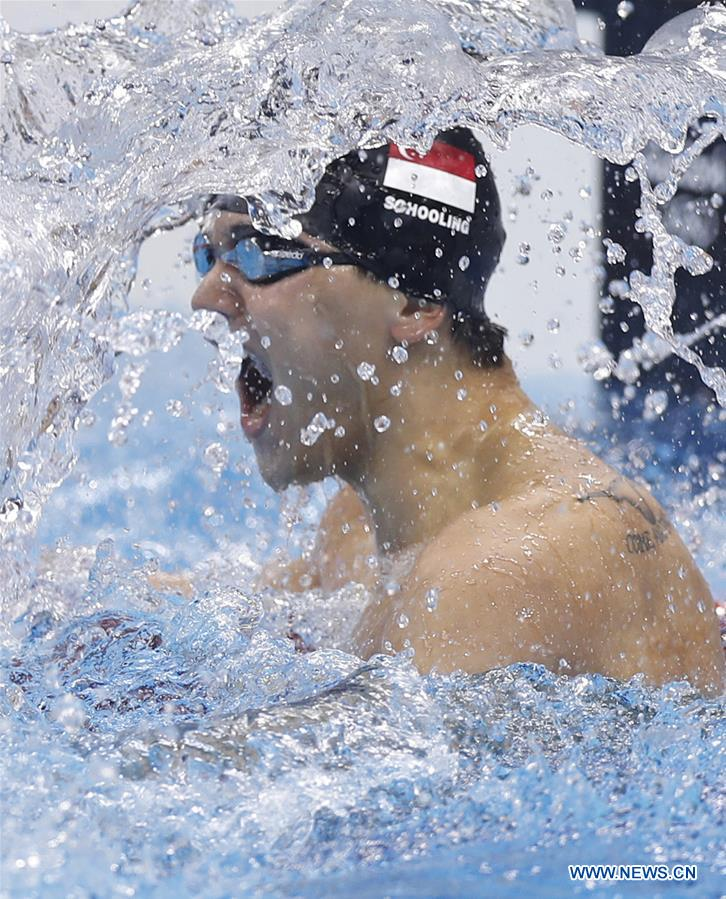 Joseph Schooling of Singapore celebrates after the men