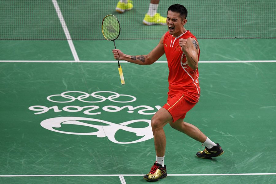 Lin Dan of China celebrates after winning his match against Srikanth Kidambi of India in badminton men