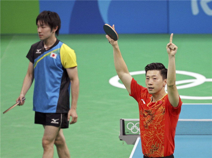 Ma Long of China gestures after winning his match against Koki Niwa of Japan in men