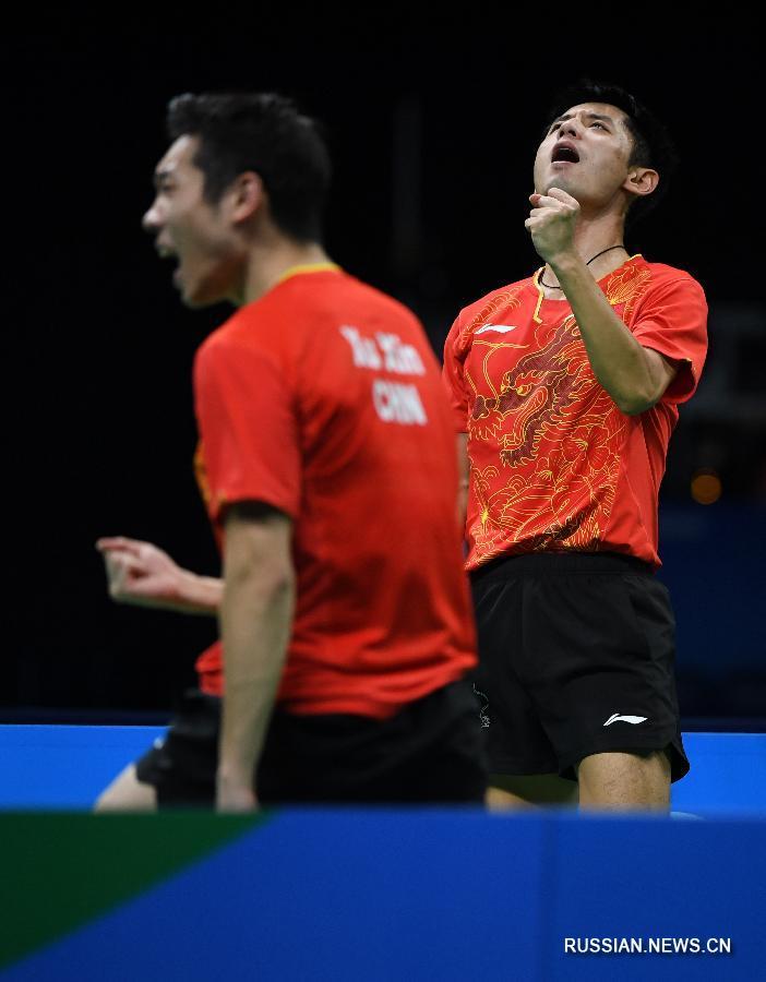 Китайские спортсмены завоевали золото Олимпиады в командном турнире по настольному теннису