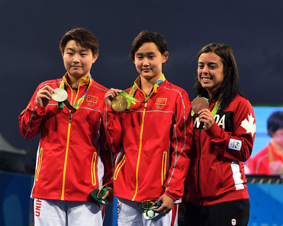 Teenage diver Ren Qian became the youngest gold medallist at the Rio Olympics by winning the 10m platform final on Thursday, Aug. 18, 2016. [Photo: Xinhua]