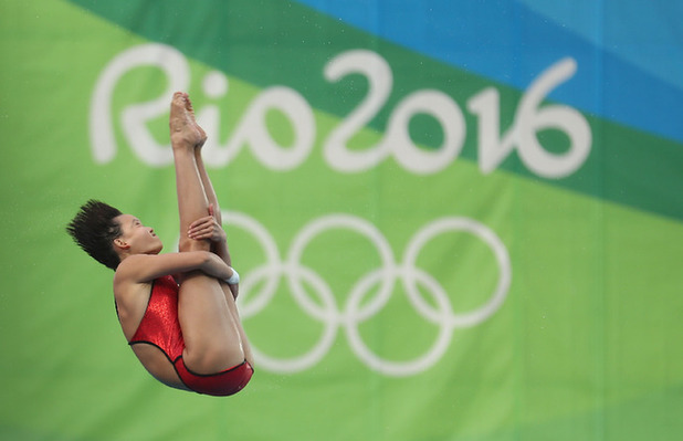 Ren Qian competes during the women