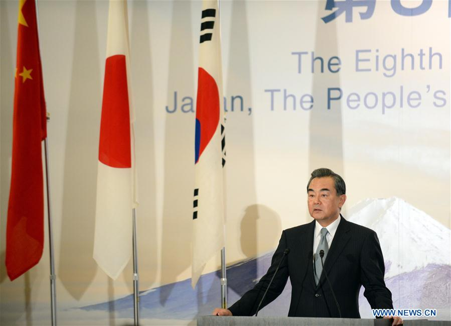 Chinese Foreign Minister Wang Yi speaks during a joint press conference in Tokyo, Japan, Aug. 24, 2016. The 8th trilateral foreign ministers