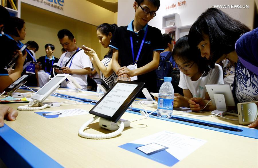 People experience e-books at Shanghai Book Fair in east China