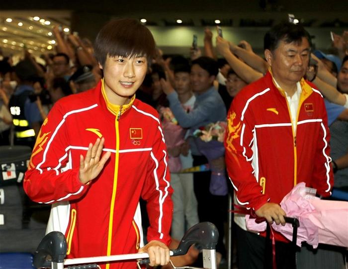 الرياضيون الصينيون يعودون إلى بلادهم