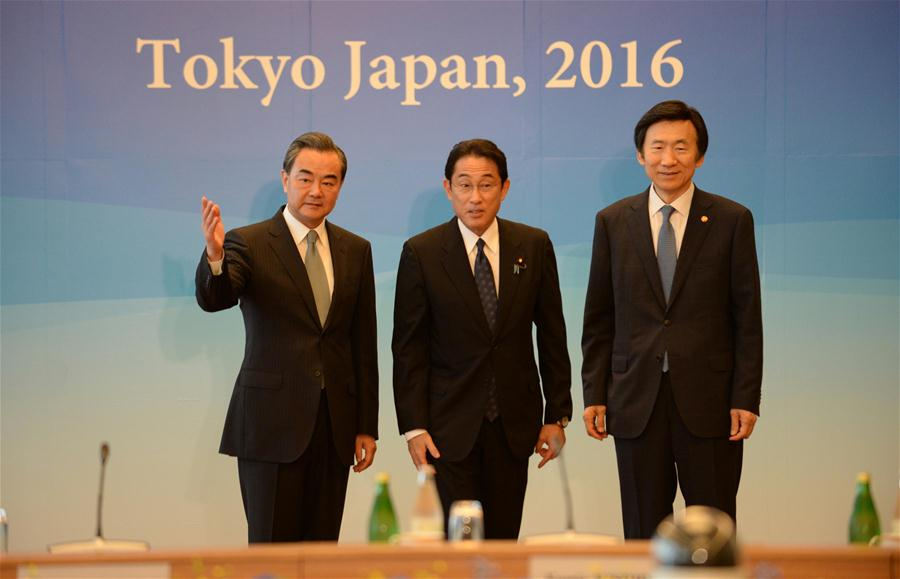 Chinese Foreign Minister Wang Yi, Japanese Foreign Minister Fumio Kishida and South Korean Foreign Minister Yun Byung-se (from L to R) attend the 8th trilateral foreign ministers