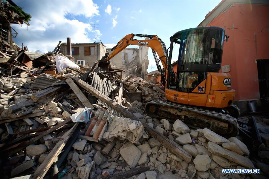 Photo taken on Aug. 24, 2016 shows an excavator working after the earthquake in Amatrice, central Italy. The death toll from a powerful earthquake in central Italy has risen to 247, Italian authorities confirmed early on Thursday.