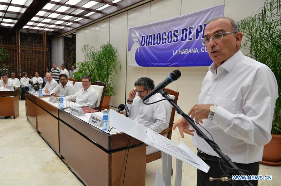 The head of the delegation of the Colombian government for the peace talks with the Revolutionary Armed Forces of Colombia (FARC) Humberto de la Calle (R) delivers a speech during the announcement by the Colombian government and FARC of reaching the final peace agreement, in Havana, Cuba, on Aug. 24, 2016. The Colombian government and the insurgent FARC announced on Wednesday that they have reached the final peace agreement to conclude the peace negotiations that have been held since November 2012 in Havana. (Xinhua/COLPRENSA)