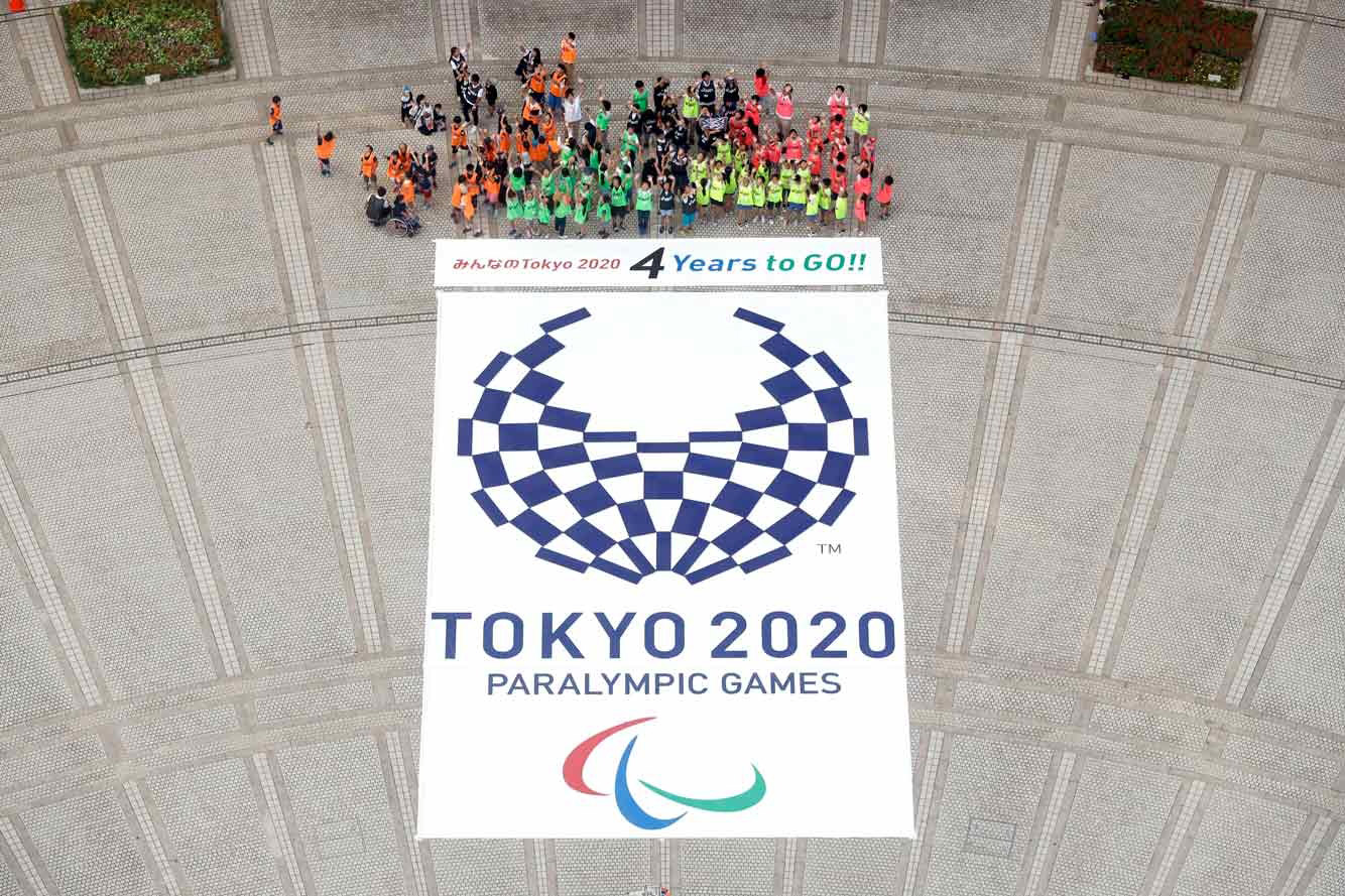 About a 100 children would rearrange the pieces of the Olympic logo to create the Paralympic emblem.
