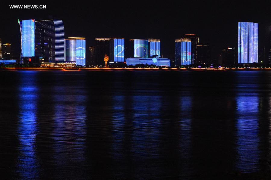 Photo taken on Aug. 27, 2016 shows buildings along Qiantang River are illuminated with the G20 logo in Hangzhou, capital of east China