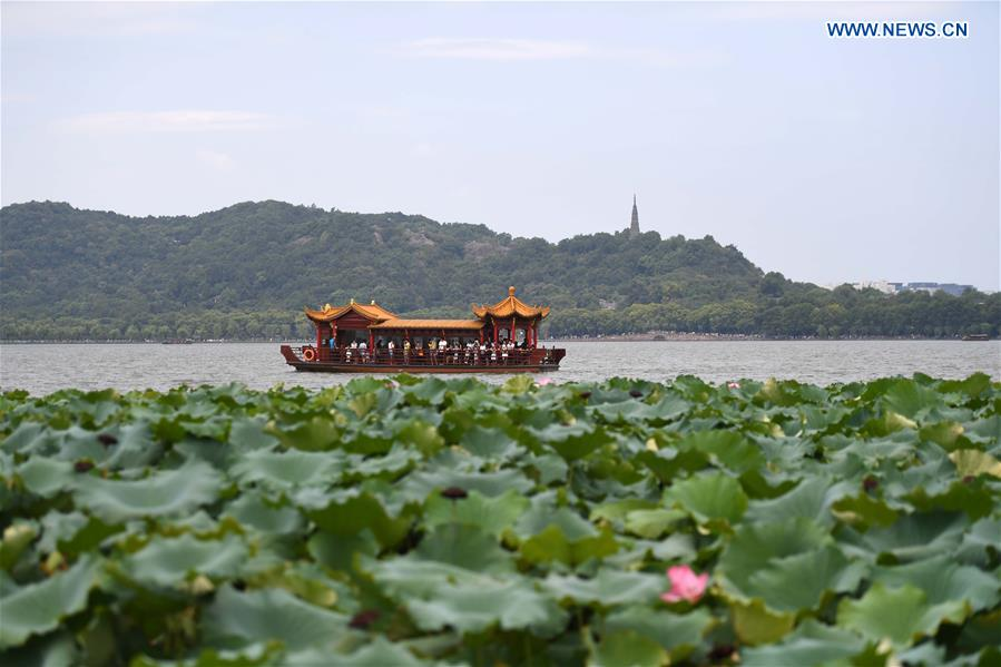 Photo taken on Aug. 27, 2016 shows a sightseeing boat on the West Lake in Hangzhou, capital city of east China