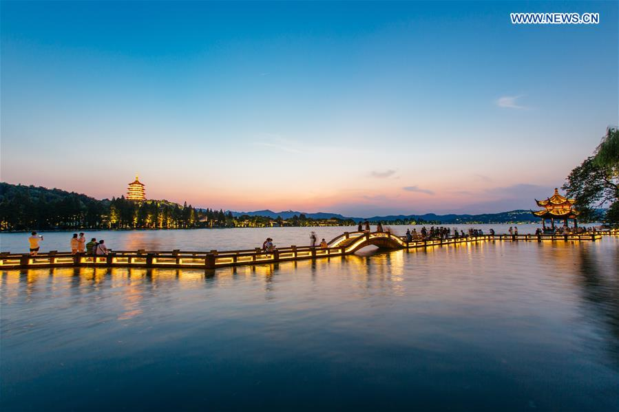 Photo taken on Aug. 29, 2016 shows the Leifeng Pagoda and Long bridge in the sunset in the West Lake in Hangzhou, capital city of east China