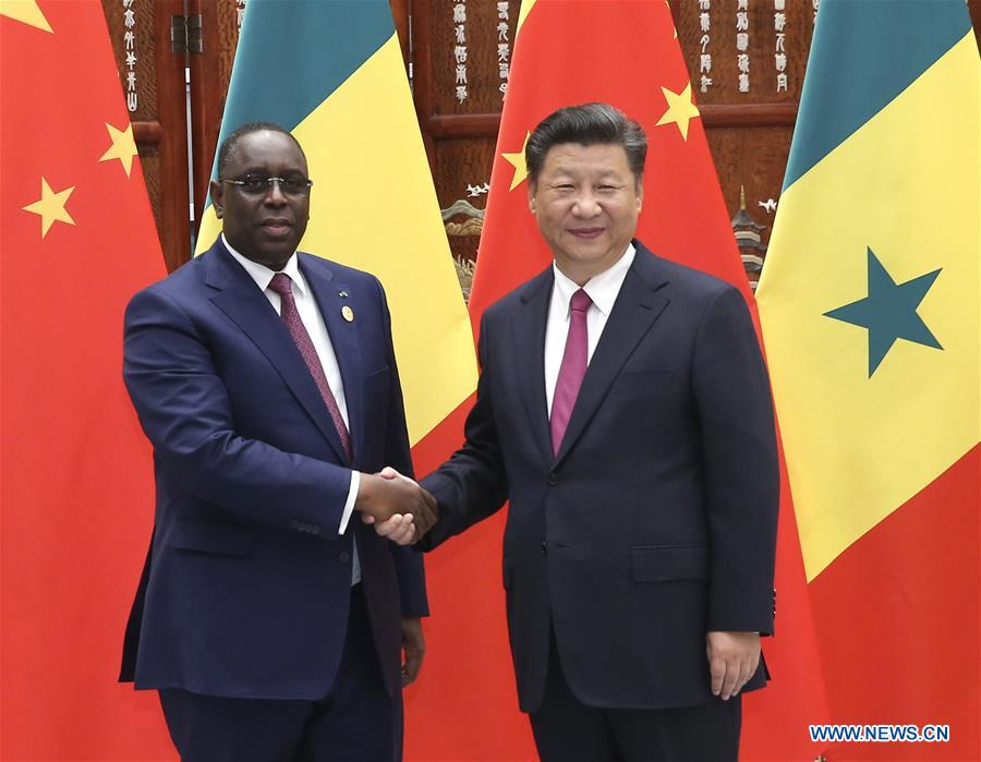 Chinese President Xi Jinping (R) meets with his Senegalese counterpart Macky Sall in Hangzhou, capital of east China