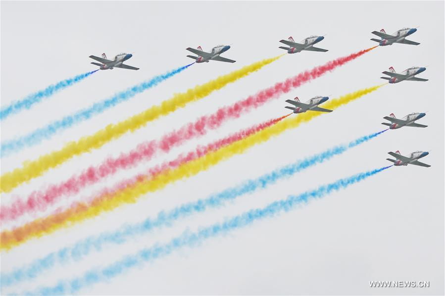 The Red Falcon Air Demonstration Team performs in the sky during the PLA Air Force Aviation Open Day in Changchun, capital city of northeast China
