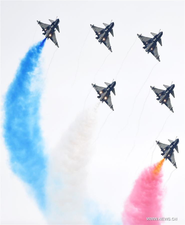 The Bayi Aerobatics Team performs in the sky during the PLA Air Force Aviation Open Day in Changchun, capital city of northeast China