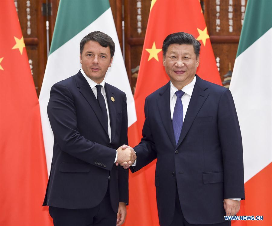 Chinese President Xi Jinping (R) meets with Italian Prime Minister Matteo Renzi in Hangzhou, capital city of east China