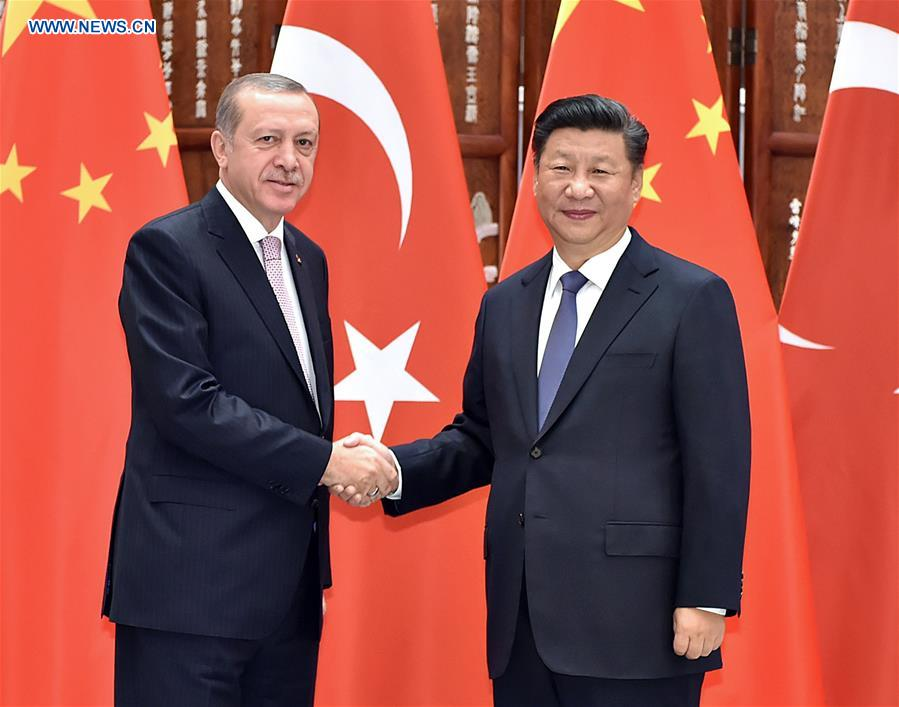 Chinese President Xi Jinping (R) meets with his Turkish counterpart Recep Tayyip Erdogan who came to Hangzhou to attend the G20 Summit in Hangzhou, capital city of east China