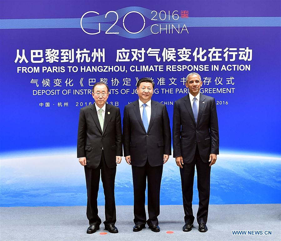 Chinese President Xi Jinping (C), U.S. President Barack Obama (R) and Secretary-General of the United Nations Ban Ki-moon attend the deposit of instruments of joining the Paris Agreement in Hangzhou, capital city of east China