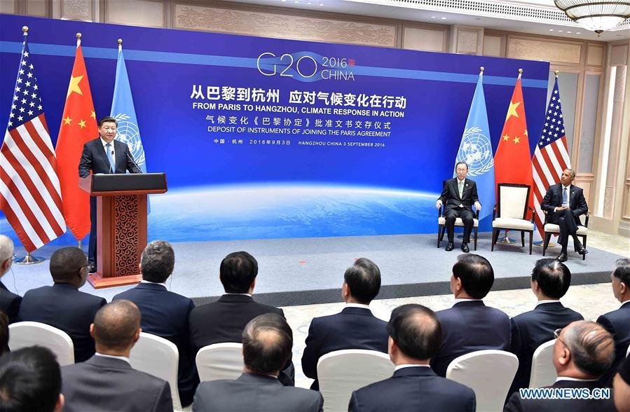 Chinese President Xi Jinping (L), U.S. President Barack Obama (R) and Secretary-General of the United Nations Ban Ki-moon attend the deposit of instruments of joining the Paris Agreement in Hangzhou, capital city of east China