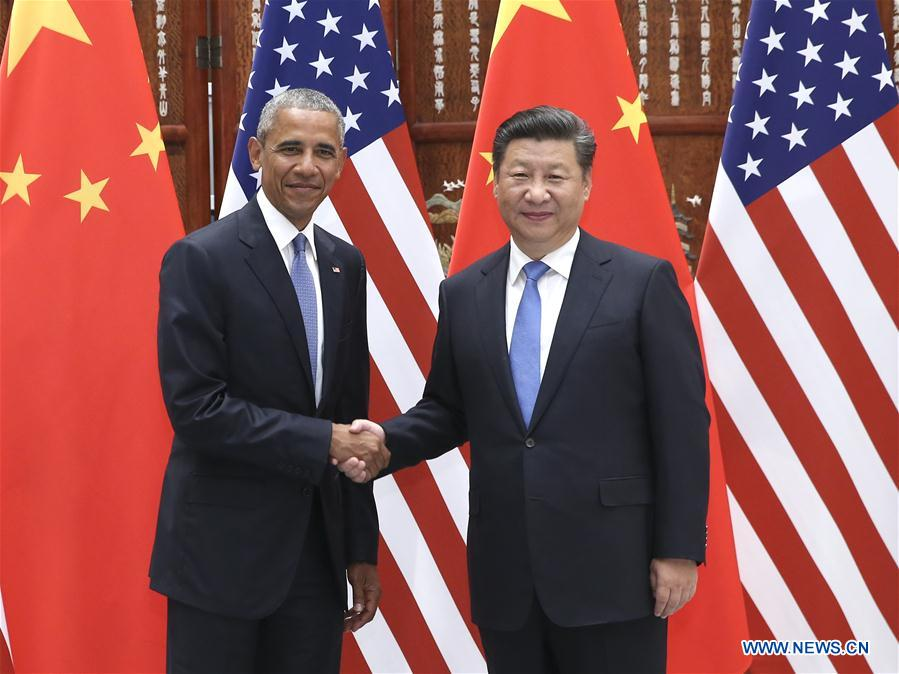 Chinese President Xi Jinping (R) meets with U.S. President Barack Obama, who is here to attend the G20 summit, in Hangzhou, capital city of east China