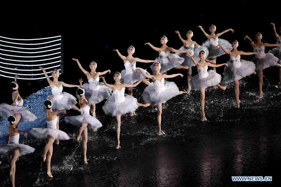 Artists dance during an evening gala for the G20 summit at the West Lake scenic zone in Hangzhou, capital of east China