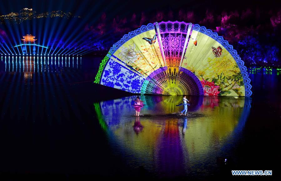 Artists perform during an evening gala for the G20 summit at the West Lake scenic zone in Hangzhou, capital of east China