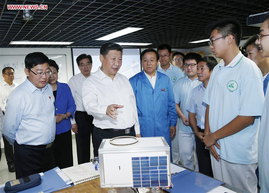 Chinese President Xi Jinping (3rd L) talks to teachers during an inspection visit to Beijing Bayi School before the upcoming national Teacher