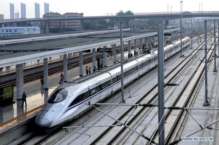 The first train operating on Zhengzhou-Xuzhou high-speed railway stops at Shangqiu Railway Station, central China