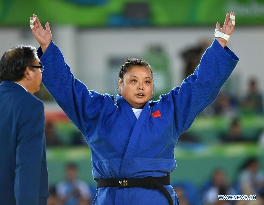 Yuan Yanping of China celebrates after the Women