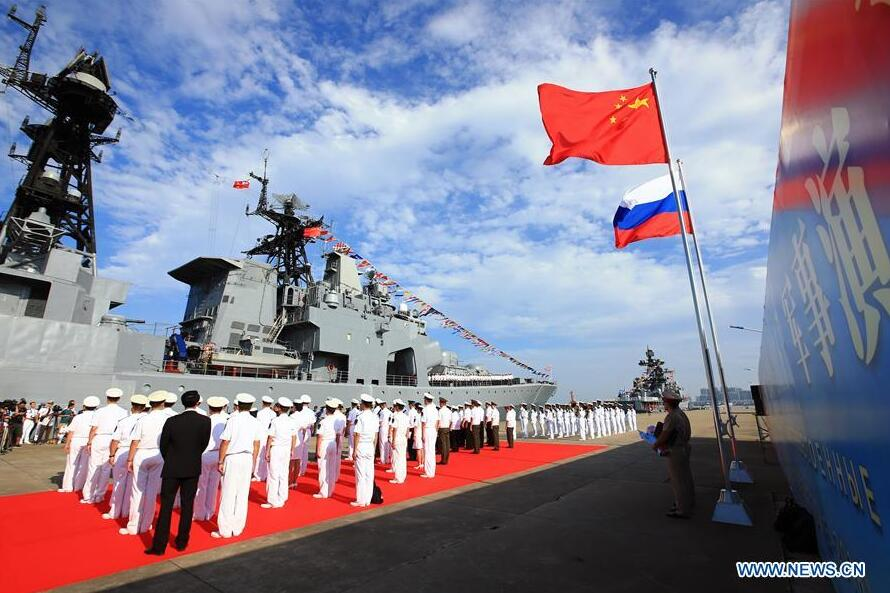 Officers and soldiers of Chinese Navy hold a welcome ceremony as a Russian fleet arrive at a port in Zhanjiang, south China