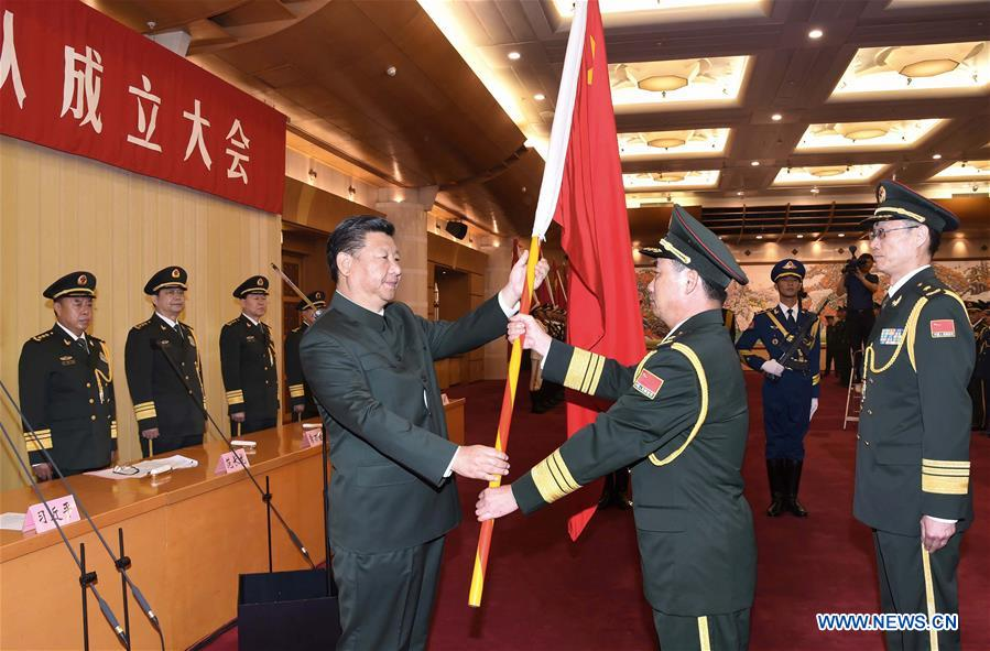 Chinese President Xi Jinping(L, front), also general secretary of the Communist Party of China (CPC) Central Committee and chairman of the Central Military Commission (CMC), confers a military flag to Commander Li Shisheng and Political Commissar Yin Zhihong of Wuhan Joint Logistics Unit as the CMC established a joint logistics support force in Beijing, capital of China, Sept. 13, 2016. (Xinhua/Li Gang)