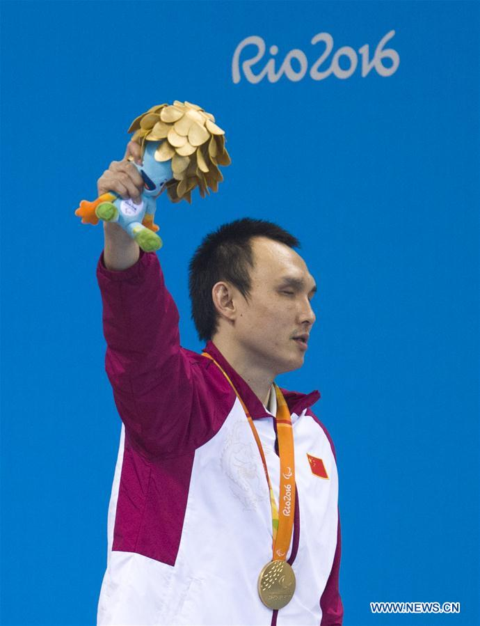 Yang Bozun of China reacts during the awarding ceremony of the men