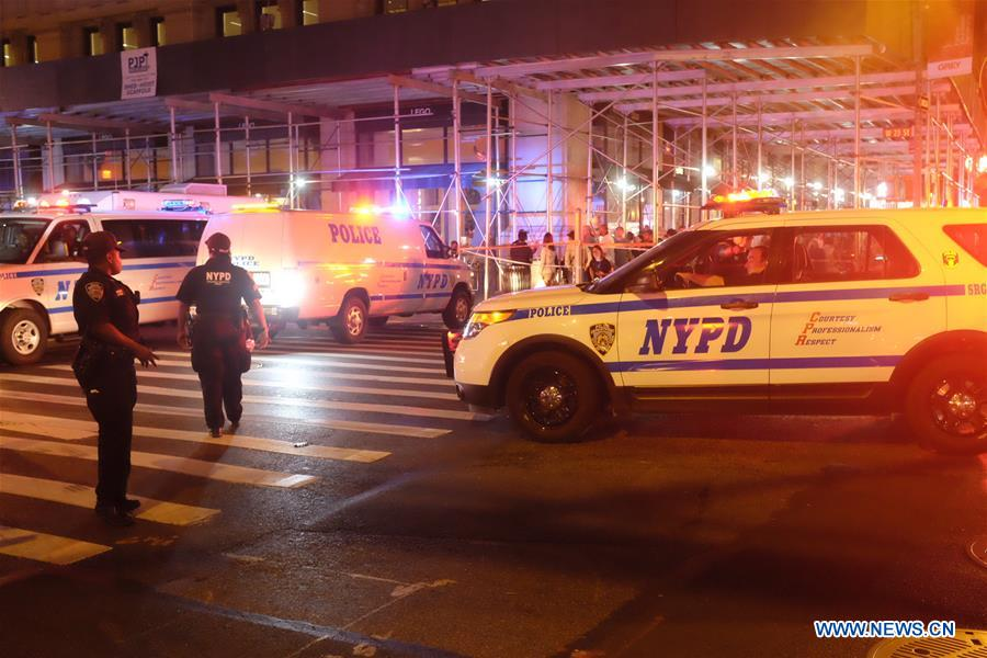 The photo taken on Sept. 17, 2016 shows policemen on duty near the site of an explosion in New York, the United States. A total of 25 people have been injured in an explosion in the Chelsea neighborhood of Manhattan on Saturday evening, and the cause of the blast is under investigation, the New York City Fire Department said. (Xinhua/Li Muzi)