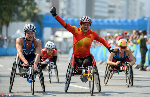 Zou Lihong of China, center, wins the gold medal in the event ahead of silver medalist Tatyana McFadden of the United States, left, during the Women