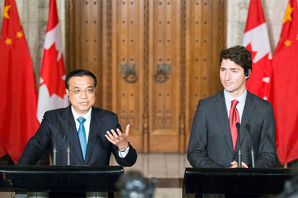 Premier Li Keqiang and Canadian Prime Minister Justin Trudeau met with journalists on Sept 22 in Ottawa, the capital city of Canada.
