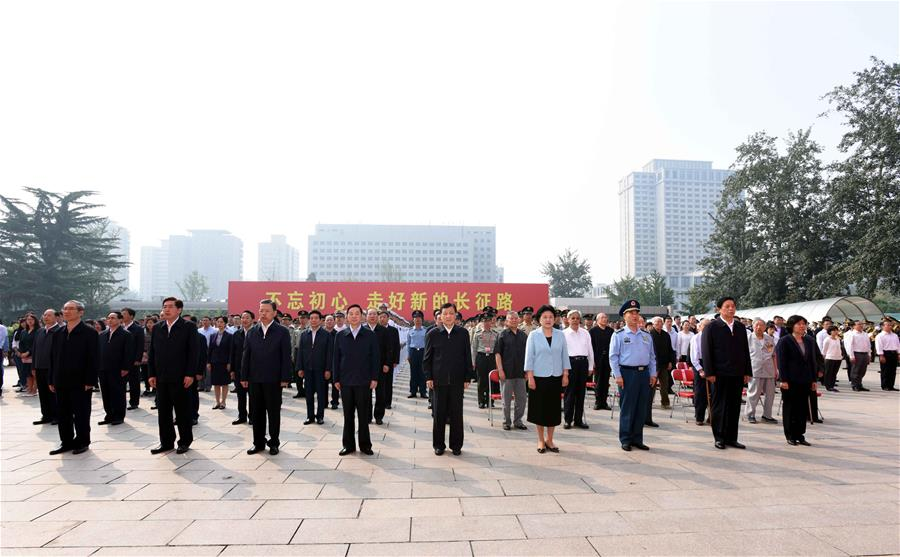 Liu Yunshan (C, front), a member of the Standing Committee of the Political Bureau of the Communist Party of China (CPC) Central Committee, attends the opening ceremony of the exhibition marking the 80th anniversary of the end of the Long March in Beijing, capital of China, Sept. 23, 2016. (Xinhua/Rao Aimin)